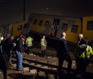 Emergency workers gather at the scene of a train collision at the Booysens train station near Johannesburg Friday July 17, 2015. A commuter train crashed into another passenger train during rush hour Friday in South Africa's largest city injuring more than 300 people, an emergency services spokeswoman said. (AP Photo/Jacques Nelles)