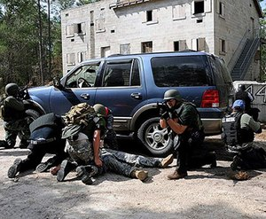 Constant, reliable communication is critical for SWAT operators, and in-ear headset systems provide the connectivity you need without interfering with your helmet and other gear. (image Wikimedia Commons)