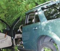 Tenn. firefighters save driver from car suspended 30 feet
