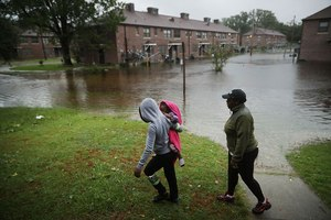Residents survey the flooding at the Trent Court public housing complex in New Bern, North Carolina, following Hurricane Florence, September 2018. Image: Getty/Chip Somodevilla