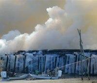 Firefighters use 11 boats, 2 choppers on rail-bridge blaze
