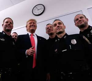 Trump has gone out of his way to demonstrate support for law enforcement throughout his presidential campaign. He has been photographed and videotaped on numerous occasions shaking hands with officers assigned to his protection detail. (AP Image)
