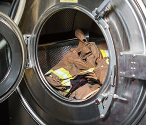 Extractors are are large washing machines that help remove carcinogens from firefighter gear. (Photo/Fire Chief)