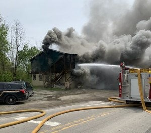 A man allegedly bit a firefighter at the scene of an apartment complex fire in Adrian, W.Va., last week.