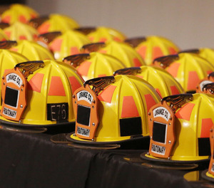 Firefigher helmets are lined up during graduation ceremonies for the recruit class of the Orange County Fire Rescue Department at Valencia College Performing Arts Center on Friday, December 14, 2018.