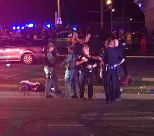 Charlotte-Mecklenburg Police respond to a shooting that left two dead and 12 injured. (Photo/WSOC)