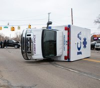2 injured after Mich. ambulance struck, flipped on its side