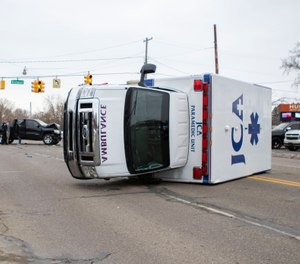 A Jackson Community ambulance lays on its side after being struck by a black Dodge Ram at an intersection on Jan. 31, 2020. (Photo/Mikayla Carter, MLive.com)