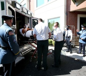 Chris Stanek waves to officers from across the state as well as rehab facility personnel as he is released from PowerBack Rehabilitation. (Photo/Lori M. Nichols for NJ.com via TNS)
