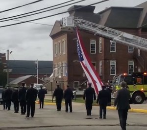 New Jersey firefighters held a procession for former Fire Commissioner Richard Gould so his family could say goodbye as they're forced to stay at home due to COVID-19. Gould died from the virus after an outbreak at the nursing home where he was a resident. (Photo/NJ Advance Media for NJ.com, Courtesy of Elizabeth Arnett Wiliams Riley)