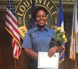 EMT Breonna Taylor, 26, who worked as an ER technician for Medical Center Jewish East, was killed by police during a raid at her home in March. Police say they were returning fire from Taylor's boyfriend when Taylor was struck. City officials have called for a federal review of the case. (Photo/Courtesy of the New York Daily News)
