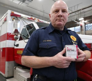 Fire District Chief Joseph Natko holds two pack of Narcan at Akron Fire station 4 on Friday Dec. 27, 2019 in Akron, Ohio. (Photo/Mike Cardew, Beacon Journal)