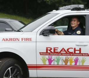 Andy Falcone, a firefighter/paramedic with the Akron Fire Department, drives the vehicle that will be used for the department's new program REACH. (Photo/Karen Schiely, Beacon Journal/Ohio.com]
