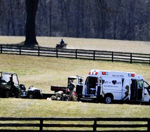 This file photo shows paramedics from Hart to Heart Ambulance tending to a jockey after a fall. The city of Baltimore is reportedly denying more than $600,000 in payment to the company after an inspector general found it increased its rates due to the COVID-19 pandemic. (Photo/Matt Button, Aegis Staff, Patuxent Homestead via The Baltimore Sun)