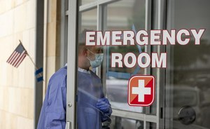 Registered nurse Keith M. prepares to take a sample at a drive-through COVID-19 test site at Austin Emergency Center. The virus has hit Texas especially hard over the past month, particularly in the state's southern most counties. Image:  Jay Janner/American-Statesman via TNS