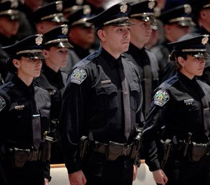 Austin police cadets stand at attention during their graduation ceremony on Jan. 31.