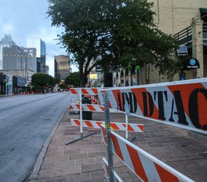 Barriers sit on the sidewalk at the 400 block of Sixth Street in Austin, Texas, where a man shot 14 people early on June 12. (file photo)