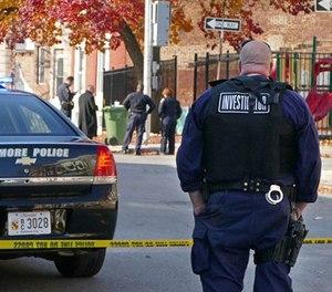 Baltimore police investigate a shooting on Nov. 30, 2017. (Lloyd Fox/Baltimore Sun/TNS)