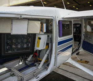 A camera array is seen in the open door of a Cessnaat Martin State Airport.