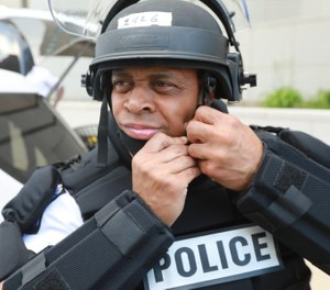 Columbus police Officer Phillip Jackson checks his riot gear as begins his shift. (Photo/Doral Chenoweth/Dispatch)