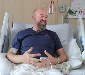 """Rittman Volunteer Firefighter Mike """"Tiny"""" Riding talks about his need for open heart surgery while laying in bed at Cleveland Clinic/Akron General on Thursday, Nov. 14, 2019 in Akron, Ohio. (Photo/Phil Masturzo, Beacon Journal)"""