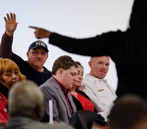 A volunteer firefighter asks a question during a town hall meeting at Buena Vista Community Center to discuss a proposed police-fire merger on Jan. 3, 2020. The town announced it is no longer considering the proposal after public backlash. (Photo/Riley Yuan, MLive.com)