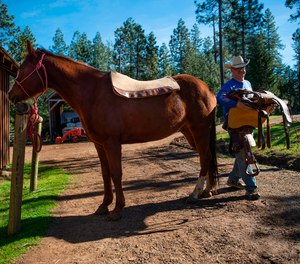 Jim Gund, 66, saddles his horse in the remote community of Kettenpom in Trinity County in February 2018.