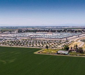 The California Health Care Facility, a prison hospital in south Stockton, houses about 2,600 inmates. Aerial photograph by drone on May 2, 2019. A patient at the prison died from Legionnaires' disease in 2018, and the inmates at the facility and two nearby youth correctional centers remain on bottled water while the water system is treated. (Hector Amezcua/Sacramento Bee/TNS)