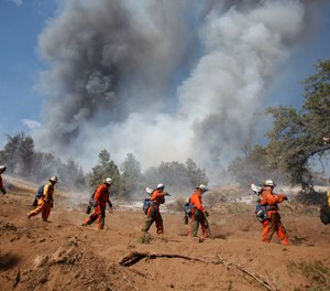 Inmate firefighters help combat a wildfire in Tehachapi, Calif., in 2010.