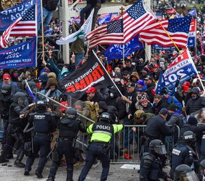 Trump supporters clash with police and security forces as they storm the U.S. Capitol in Washington, D.C, on Jan. 6, 2021.