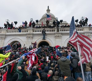 Pro-Trump supporters push back against police at the United States Capitol Building in Washington, D.C., on Jan. 6.