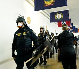 Police arrive at the Capitol to confront protesters during the joint session of the 117th Congress on Wednesday, Jan. 6, 2021, in Washington, D.C.