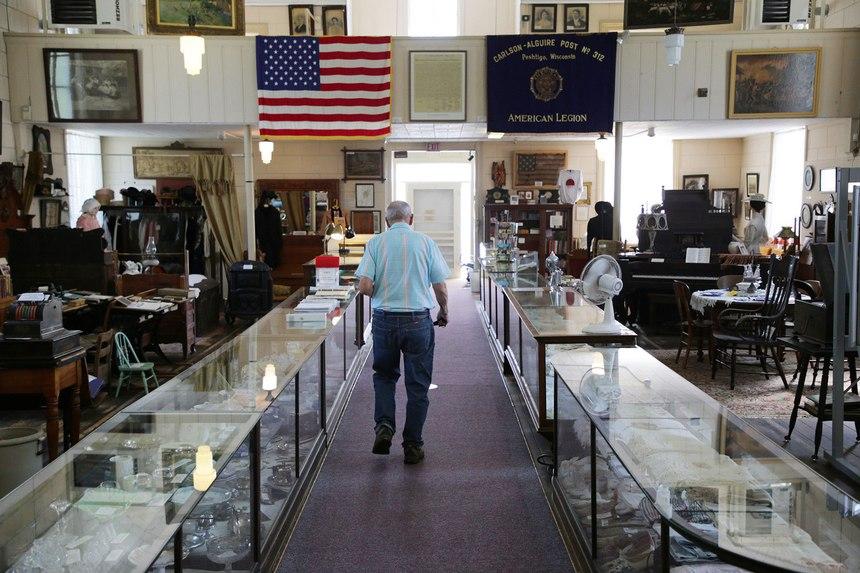 Cubby Couvillion, 95, walks down the aisle of the Peshtigo Fire Museum onSept. 1, 2021, inPeshtigo, Wisconsin.