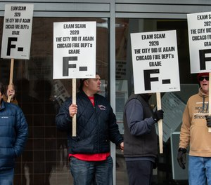 Chicago firefighters picket in front of the city's public safety headquarters in protest of problems during a recent promotional exam.