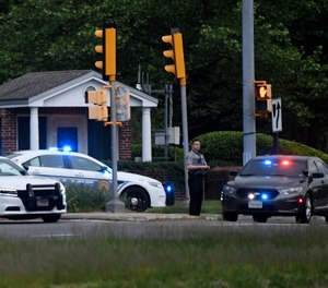 Police cars are seen outside the CIA headquarters' gate after an attempted intrusion earlier in the day in Langley, Virginia, on May 3, 2021.
