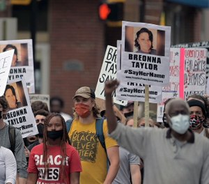 People walk in downtown Baltimore during a protest regarding the lack of charges brought against Louisville police in the killing of Breonna Taylor Sat., Sept. 26, 2020. (Karl Merton Ferron/Baltimore Sun Staff)