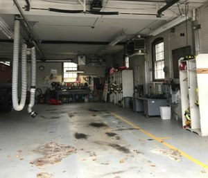 This bay at Station 7 on Spooner Street was empty Thursday after the pump truck had to be evacuated to prevent the floor from collapsing. (Wicked Local Photo via Tribune News Service/Emily Clark)