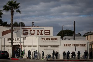 A line at the Martin B. Retting gun store in Culver City, Calif., on Sunday, March 15, 2020 extends out the door and around the corner. Image: Francine Orr/ Los Angeles Times/TNS