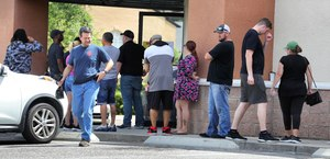 Shoppers wait in line outside the Shoot Straight gun store in Casselberry, Fla. on Sunday, March 22, 2020. The demand for firearms has skyrocketed in recent days due to the coronavirus pandemic. Image: Joe Burbank/Orlando Sentinel/TNS