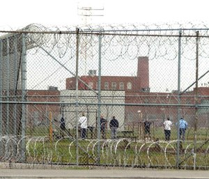 Inmates at Marion Correctional Institution in Marion exercise in the prison yard. (Photo/Bill Sinden of Marion Star via TNS)