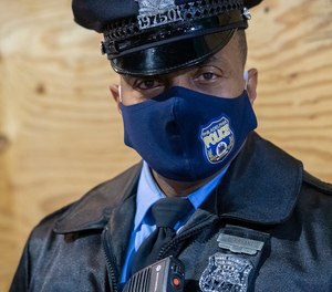 A Philadelphia police officer wears a branded face mask.