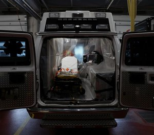 A ambulance that has been wrapped in plastic sheeting for transporting coronavirus patients is pictured inside the Upper Merion Fire and EMS station in King of Prussia, Pa., on Friday, April 3, 2020. Public safety officials say the COVID-19 pandemic will put a strain on Pennsylvania's already fragile EMS system, especially in small towns and rural areas.