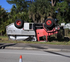 A firefighter was injured April 2, 2020, in a rollover crash in Palm Beach County, Fla. (Photo/Palm Beach County Fire Rescue)