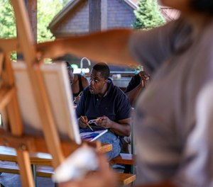 Allen Carter paints a picture during an art therapy session at the Youth Justice Fund's 2020 Trauma Summer Camp. YJF is a nonprofit that assists with re-entry for people sentenced to prison as youth.