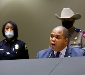 Dallas Mayor Eric Johnson opposed a budget amendment that passed that will cut $7 million from police overtime and reinvest it in public safety, including the hiring of 95 civilians to replace officers in desk jobs. (Photo/Juan Figueroa/Staff Photographer)