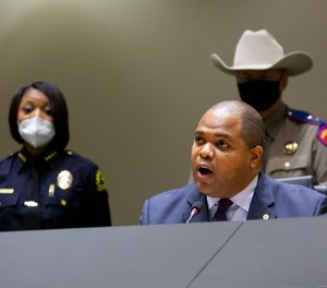 Dallas Mayor Eric Johnson opposed a budget amendment that passed that will cut $7 million from police overtime and reinvest it in public safety, including the hiring of 95 civilians to replace officers in desk jobs.