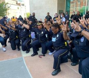 Police in Dallas hold a