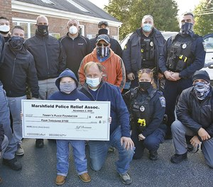 Danny Sheehan, 7, of Marshfield, who is battling cancer, receives a $4k check from the Marshfield Police Relief Association for