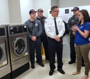 Laura Chorost, right, speaks with DeLand Fire Chief Todd Allen about why DaVita Labs donated two sets of industrial-grade washers and dryers to the fire department on Friday, Jan. 31, 2020. Chorost, who previously worked as a lieutenant with Volusia County Fire, is the environmental, health and safety administrator at DaVita Labs in DeLand. (Photo/News-Journal, Katie Kustura)