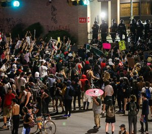 Protesters demonstrated at Austin police headquarters Sunday night. A volunteer first aid team called Street Medics Austin treated hundreds for heat exhaustion, police projectile injuries and the effects of pepper spray over the weekend.